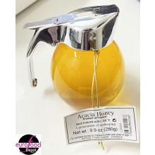 Acacia honey in pour spout by Apidis